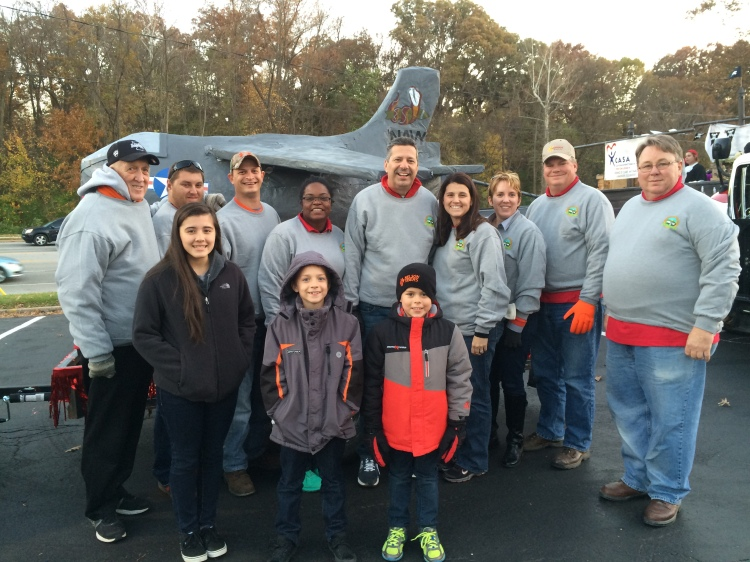 Members of Edwardsville Township Board, park personnel and administrative staff debut the Airplane Overhaul float at the Edwardsville Halloween Parade October 31, 2014.